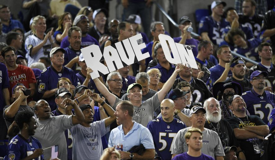 In this Sept. 11, 2014, file photo, football fans cheer during the first half of an NFL football game between the Pittsburgh Steelers and the Baltimore Ravens in Baltimore. (AP Photo/Nick Wass, File)  **FILE**