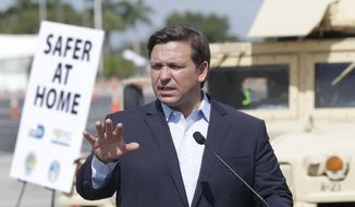 Florida Gov. Ron DeSantis speaks during a news conference at a drive-through coronavirus testing site in front of Hard Rock Stadium, Monday, March 30, 2020, in Miami Gardens, Fla. Gov. Ron DeSantis doesn't want the people on the Holland America's Zandaam where four people died and others are sick to be treated in Florida, saying the state doesn't have the capacity to treat outsiders as the coronavirus outbreak spreads. (AP Photo/Wilfredo Lee)