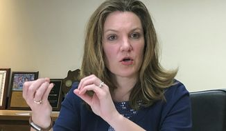 FILE - In this March 12, 2019 file photo, Andrea Palm, then Secretary-designee of the Wisconsin Department of Health Services, speaks during a meeting with reporters in Madison, Wis. Medicaid enrollment in Wisconsin is expected to increase dramatically due to the coronavirus pandemic, requiring the Legislature to take swift action to bolster the program that serves more than 1 million poor, elderly and disabled people, the state's health secretary Andrea Palm warned legislative leaders in a letter, Tuesday March 31, 2020. (AP Photo/Scott Bauer)
