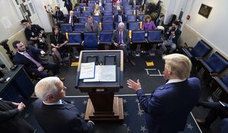 Vice President Mike Pence, left, and President Donald Trump speak about the coronavirus in the James Brady Press Briefing Room of the White House, Wednesday, April 1, 2020, in Washington. (AP Photo/Alex Brandon)