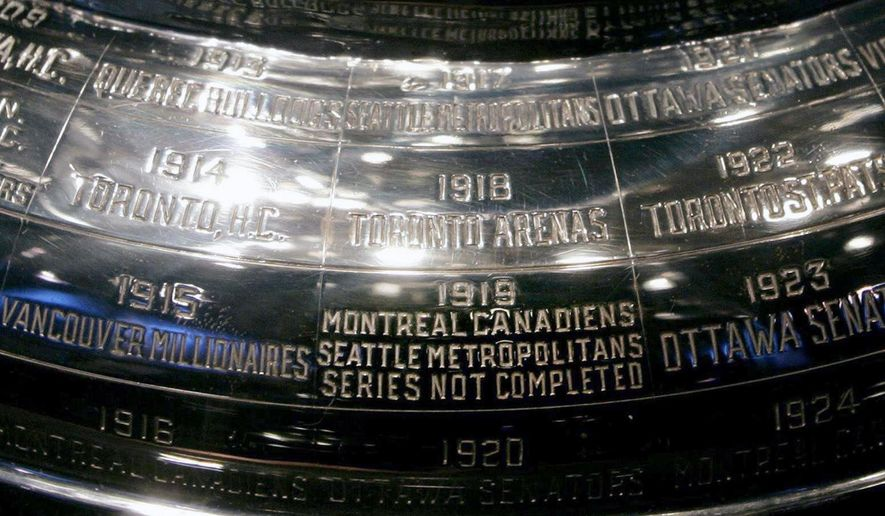 FILE - In this Feb. 4, 2005, file photo, the inscription on the Stanley Cup showing the 1919 series, the only series in the history of the cup not completed, is shown at the Hockey Hall of Fame in Toronto. The Seattle Metropolitans were on the verge of winning their second Stanley Cup in three years back in 1919. They never got to celebrate. Neither did the Montreal Canadiens, their opponent in the series. (Adrian Wyld/The Canadian Press via AP