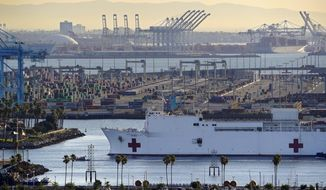 FILE - In this March 27, 2020, file photo, The USNS Mercy enters the Port of Los Angeles in Los Angeles. A train engineer intentionally drove a speeding locomotive off a track at the Port of Los Angeles because he was suspicious about the presence of a Navy hospital ship docked there amid the coronovirus crisis. The locomotive crashed through a series of barriers before coming to rest more than 250 yards from the U.S. Navy Hospital Ship Mercy on Tuesday, March 31, 2020. Nobody was hurt. (AP Photo/Mark J. Terrill, File)