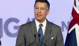 FILE - This Feb. 24, 2018, file photo shows then-Gov. Brian Sandoval of Nevada at the National Governor Association 2018 winter meeting in Washington, D.C. Former Gov. Sandoval is stepping down from his position at MGM Resorts to pursue the presidency at the University of Nevada, Reno. The state Board of Regents also announced Wednesday, April 1, 2020, it intends to identify a candidate to serve as president at UNR while it continues a search for a permanent replacement to outgoing President Marc Johnson for the rest of the year. (AP Photo/Jose Luis Magana, File)