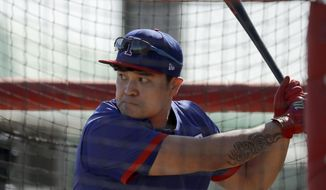 Texas Rangers' Shin-Soo Choo bats during spring training baseball practice Monday, Feb. 17, 2020, in Surprise, Ariz. (AP Photo/Charlie Riedel)  **FILE**
