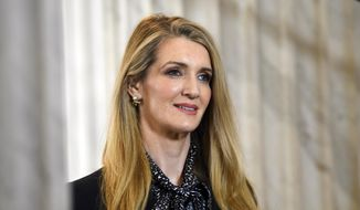 Sen. Kelly Loeffler, R-Ga., waits to speak during a television interview on Capitol Hill in Washington, Friday, March 20, 2020. (AP Photo/Susan Walsh) ** FILE **