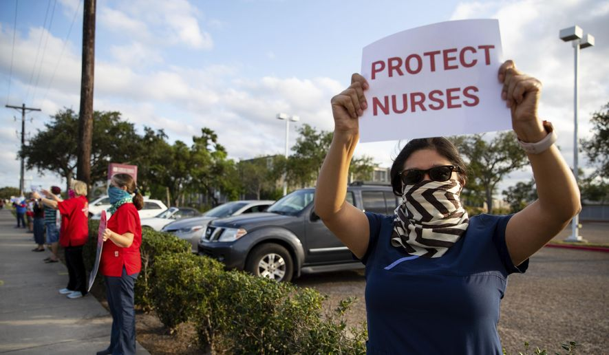 Nurses at Corpus Christi Medical Center - Doctor's Regional protests the lack of personal protective equipment and COVID-19 preparedness at the hospital in Corpus Christi, Texas on Wednesday, April 1, 2020. (Courtney Sacco/Corpus Christi Caller-Times via AP)
