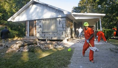 Members of the Mobile County Sheriff's Department Inmate Work Crew prepare Hank Aaron's childhood home for it's move, in Mobile, Ala. Tuesday, Oct. 21, 2008. The house is scheduled to be moved to Hank Aaron Stadium on Friday and will be renovated to what it was when Hank Aaron's father Herbert first built it in the 1940s. It will then be turned into the Hank Aaron Museum and Learning Center where it will house Aaron memorabilia and offer glimpses into Mobile's baseball history. (AP Photo/Press-Register, Bill Starling)