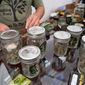 A large percentage of marijuana businesses claim tax deductions for expenses that are not permitted under federal rules, but the IRS inspector general says the government is partly to blame. (Associated Press)
