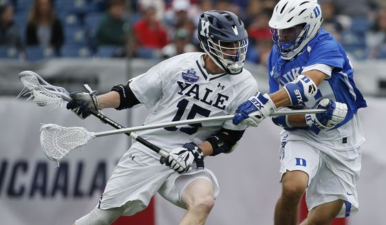 In this May 28, 2018, file photo, Yale's Jackson Morrill (15), left, is defended by Duke's Kevin McDonough during the first half of an NCAA college Division I championship final lacrosse game, in Foxborough, Mass. The Ivy League has decided not to allow its spring-sport athletes who had their seasons shortened by the coronavirus pandemic to have an additional year of eligibility, despite the NCAA granting that option earlier this week. The move, which was announced Thursday, April 2, 2020, was consistent for the Ivy League, which hasn't allowed athletes who received medical redshirts to play for a fifth year. Yale is an Ivy League school. (AP Photo/Michael Dwyer, File)  **FILE**
