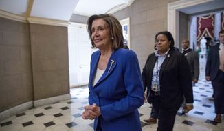 In this March 27, 2020, photo, House Speaker Nancy Pelosi of Calif., walks to her office after signing the Coronavirus Aid, Relief, and Economic Security (CARES) Act on Capitol Hill in Washington. (AP Photo/Andrew Harnik) **FILE**