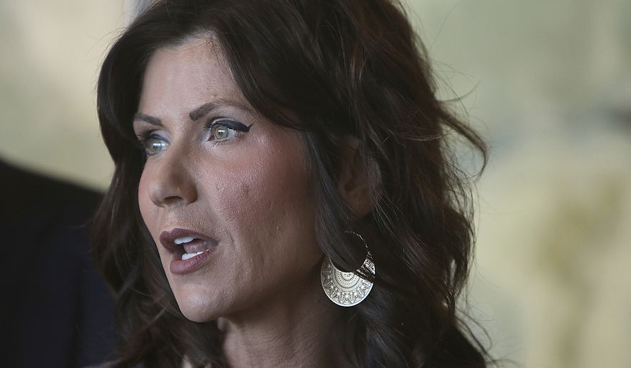 In this Wednesday, March 18, 2020, file photo, South Dakota Gov. Kristi Noem speaks in Rapid City, S.D. Noem on Thursday, April, 2, 2020, said she was activating the National Guard to set up temporary hospitals in Sioux Falls and Rapid City. Ms. Noem is one of nine U.S. state governors as of April 4 who has not issued a statewide shelter--in-place order. (Jeff Easton/Rapid City Journal via AP, File)