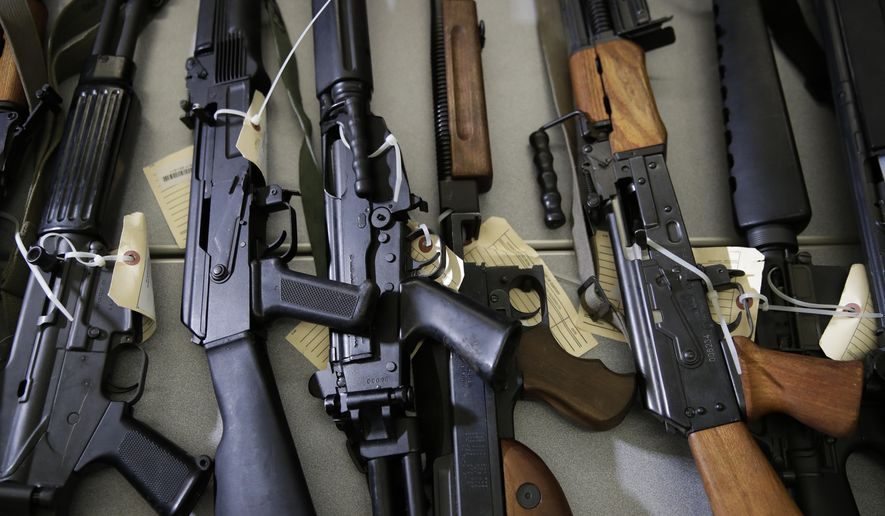 In this Oct. 9, 2018, photo, Illegally possessed firearms seized by authorities are displayed during a news conference in Los Angeles. State authorities cleared 8.6% fewer cases last year into people who are no longer are allowed to own firearms, down from a record high in 2018, through a unique California program according to a California Department of Justice report released Wednesday, April 1, 2020. (AP Photo/Jae C. Hong) **FILE**
