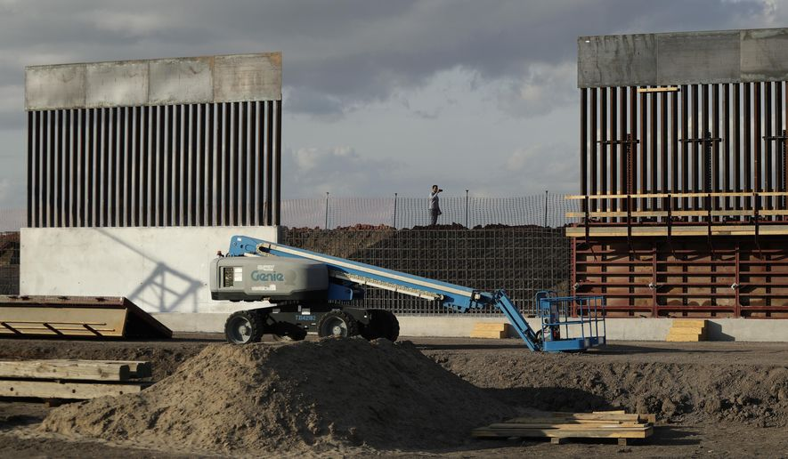 In this Nov. 7, 2019, file photo, the first panels of levee border wall are seen at a construction site along the U.S.-Mexico border, in Donna, Texas. (AP Photo/Eric Gay, File)
