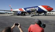 In this Oct. 4, 2017, file photo, the New England Patriots customized Boeing 767 jet rests on the tarmac at T.F. Green Airport, in Warwick, R.I. The Patriots private team plane is expected to land in Boston on Thursday, April 2, 2020, returning from China with more than one million masks to help control the spread of the coronavirus. The new coronavirus causes mild or moderate symptoms for most people, but for some, especially older adults and people with existing health problems, it can cause more severe illness or death. (AP Photo/Steven Senne, File)  **FILE**