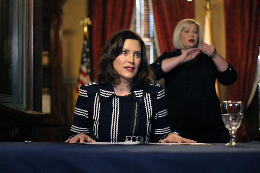 In this photo provided by the Michigan Office of the Governor, Michigan Gov. Gretchen Whitmer addresses the state during a speech in Lansing, Mich., Thursday, April 2, 2020. The governor ordered that students in the state will not return to K-12 school buildings the rest of the academic year due to the coronavirus pandemic and instead will learn remotely. All public and private schools are more than halfway through a four-week shutdown ordered by Whitmer to combat the outbreak. (Michigan Office of the Governor via AP)