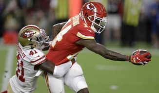San Francisco 49ers defensive back Emmanuel Moseley, left, tackles Kansas City Chiefs wide receiver Sammy Watkins during the first half of the NFL Super Bowl 54 football game Sunday, Feb. 2, 2020, in Miami Gardens, Fla. (AP Photo/Chris O'Meara)