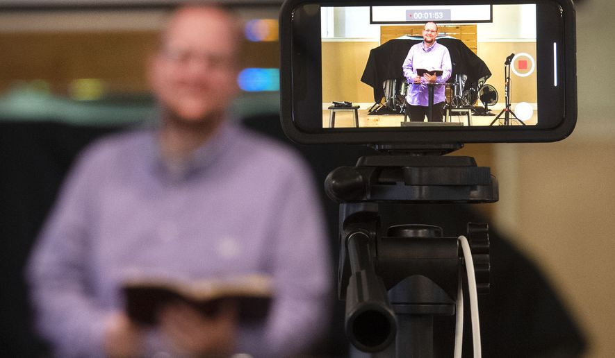 Cross Point Church Pastor Keith Williams preaches to his congregation via online video due to the ongoing COVID-19 pandemic.. The Bristol Tennessee church has gone to strictly online services and are planning for Easter to be online as well. (David Crigger/Bristol Herald Courier via AP)