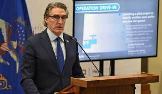 North Dakota Governor Doug Burgum announced Friday, April 3, 2020, a pilot project to identify positive cases of COVID-19 earlier to slow the spread of Coronavirus in North Dakota. The project involves residents of Amidon, Marmarth and Gladstone in the southwest part of the state only. Burgum said the project, Operation Drive-In, will be conducted today and allows only residents of those communities to be tested. (Tom Stromme/The Bismarck Tribune via AP)