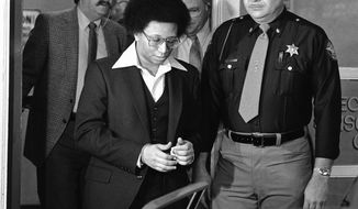 """FILE - This Feb. 23, 1982 file photo shows Wayne B. Williams leaving the Fulton County Jail in Atlanta to go to court where he will continue testifying in his trial on charges of killing two black children in Atlanta. Williams was given two life sentences in connection to two of the 29 murders. A new HBO documentary """"Atlanta's Missing and Murder: The Lost Children"""" will take a deep dive into the case involving a string of murders that terrorized the city's black community 40 years ago. With Atlanta's mayor pushing to reopen in the case, the five-part series that airs Sunday will explore if Williams or anyone else was truly behind the killing spree. (AP Photo/Gary Gardiner, File)"""