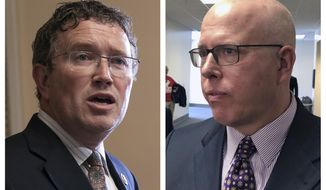 This combination of 2019 file photos shows U.S. Rep. Thomas Massie, R-Ky., left, in Washington, and Todd McMurtry, an attorney who represented a Kentucky student embroiled in media lawsuits after a viral encounter with a Native American activist, in Frankfort, Ky. In 2020, while Massie defends his lone-wolf effort to resist a $2.2 trillion coronavirus-relief package, McMurtry, his primary campaign opponent in Kentucky is pouncing with a new TV ad accusing the Republican incumbent of betraying President Donald Trump. (AP Photo/J. Scott Applewhite, Adam Beam)