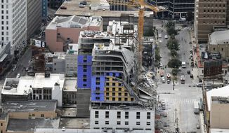 FILE - This Saturday, Oct. 12, 2019 file photo shows the Hard Rock Hotel, which was under construction, after a fatal partial collapse in New Orleans.  A federal agency has issued citations against a dozen companies in connection with last fall's deadly partial collapse of a hotel under construction in New Orleans, Friday, April 3, 2020. (AP Photo/Gerald Herbert, File)