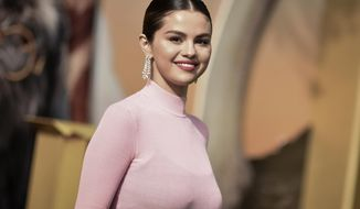"""FILE - In this Jan 11, 2020 file photo, Selena Gomez attends the premiere of """"Dolittle"""" in Los Angeles. Gomez says she was recently diagnosed with bipolar disorder. The 27-year-old spoke about her diagnosis in a 20-minute conversation Friday while on Miley Cyrus' """"Bright Minded"""" series on Instagram. (Photo by Richard Shotwell/Invision/AP, File)"""