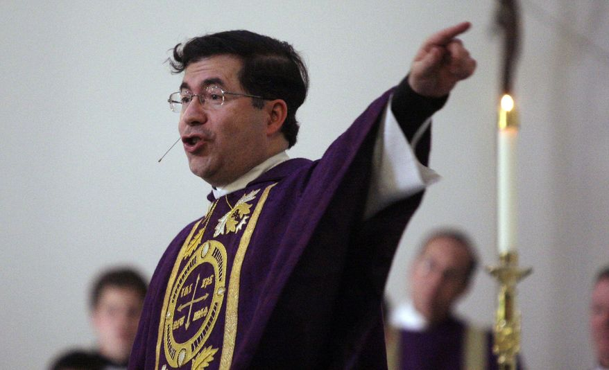 In this March 31, 2009 file photo, the Rev. Frank Pavone, head of Priests for Life, gives the Homily during a Mass at Ave Maria University's Oratory in Naples, Fla. (Greg Kahn/Naples Daily News via AP) ** FILE **