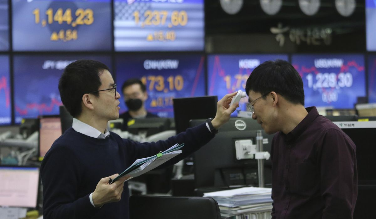 Asian stocks tumble after Wall Street rises on pricier oil