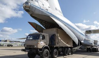 FILE - In this March 22, 2020 file photo distributed by Russian Defense Ministry Press Service, a military truck loads medical supplies for Italy on a board of an Il-76 cargo plane in Chkalovsky military airport outside Moscow, Russia. From tiny San Marino wedged next to two of Italy's hardest-hit provinces in the coronavirus outbreak to more economically powerful nations like Italy, countries are running up against export bans and seizures in the scramble for vital medical supplies. The new coronavirus causes mild or moderate symptoms for most people, but for some, especially older adults and people with existing health problems, it can cause more severe illness or death.  (Alexei Yereshko, Russian Defense Ministry Press Service via AP)