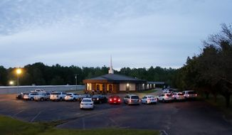 Congregants remain in their cars during a prayer service held outside at First United Pentecostal Church, Thursday, April 2, 2020, in Brandon, Miss. (AP Photo/Julio Cortez) **FILE**