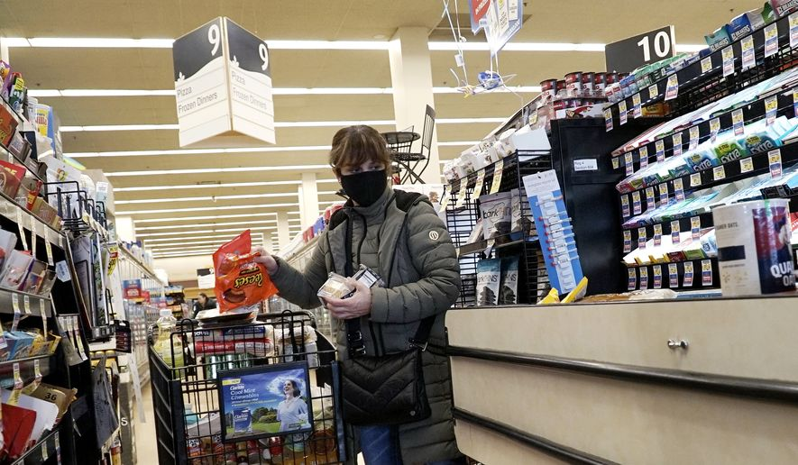 In this file photo, a customer wears a mask as she shops at a Jewel Osco grocery store in Mount Prospect, Ill., Saturday, April 4, 2020. Montgomery County, Md., is now requiring grocery shoppers to wear face masks while in the store. (AP Photo/Nam Y. Huh) **FILE**