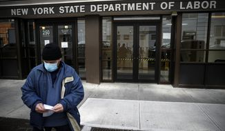 In this Wednesday, March 18, 2020, file photo, Visitors to the Department of Labor are turned away at the door by personnel due to closures over coronavirus concerns in New York. Americans are seeking unemployment benefits at unprecedented levels due to the coronavirus, but many are finding more frustration than relief. (AP Photo/John Minchillo, File)