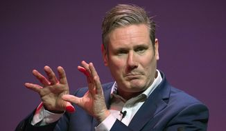 Labour leadership candidate Keir Starmer gestures, during the Labour leadership hustings at the SEC centre, in Glasgow, Scotland, Saturday, Feb. 15, 2020. The race to succeed Jeremy Corbyn as the next leader of Britain's main opposition Labour Party has narrowed to three after Emily Thornberry was narrowly eliminated from the leadership contest. (Jane Barlow/PA via AP)