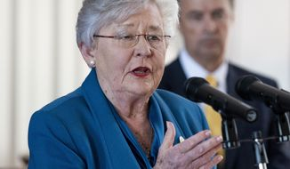 Alabama Gov. Kay Ivey announces that she is putting the state under a shelter-in-place order during a briefing at the state capitol building in Montgomery, Ala., Friday, April 3, 2020. (Mickey Welsh/The Montgomery Advertiser via AP)