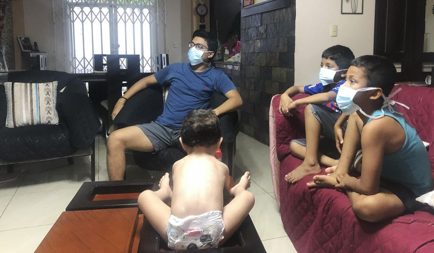 In this March 26, 2020, photo, relatives of Bella Lamilla the first person to be diagnosed with coronavirus in Ecuador, maintain quarantine in their home in Babahoyo, Ecuador. The spreading global pandemic has tested the competing interests of public health and privacy, with thousands of individuals and families experiencing both physical illness and the less-discussed stigma that can come with it. While there are many stories about good deeds and people coming together, the coronavirus is also bringing out another, darker side of some people: Fear, anger, resentment and shaming. (AP Photo/Mariuxi Orellana)