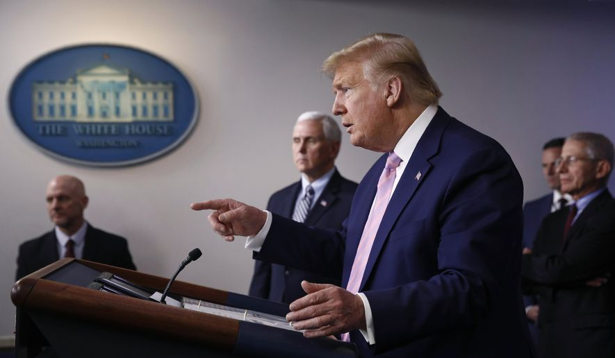 President Donald Trump speaks during a coronavirus task force briefing at the White House, Saturday, April 4, 2020, in Washington. Standing alongside are Food and Drug Administration Commissioner Dr. Stephen Hahn, from back left, Vice President Mike Pence and Dr. Anthony Fauci, director of the National Institute of Allergy and Infectious Diseases. (AP Photo/Patrick Semansky) ** FILE **