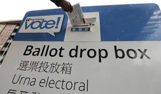 In this March 10, 2020, file photo, voters drop off ballots in the Washington state primary in Seattle. President Donald Trump and Democrats are bickering over how to provide voters with safe and secure access to a ballot as coronavirus rages in the U.S. and the pandemic could extend into the fall, affecting the general election. (AP Photo/John Froschauer) ** FILE **