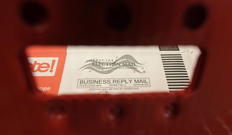A box of ballots mailed in for the Washington state primary election are shown at the King County Elections headquarters in Renton, Wash. (AP Photo/Ted S. Warren, File)