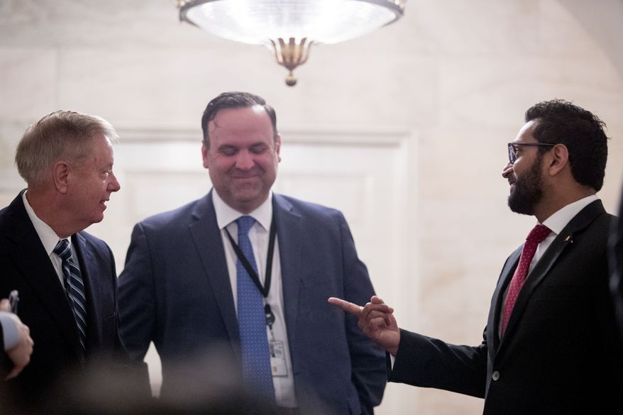 From left, Sen. Lindsey Graham, R-S.C., White House Social Media Director Dan Scavino, and National Security Council Senior Director of Counterterrorism Kashyap 'Kash' Pramod Patel, speak outside the Diplomatic Room as President Donald Trump speaks at the White House in Washington, Sunday, Oct. 27, 2019, to announce that Islamic State leader Abu Bakr al-Baghdadi has been killed during a US raid in Syria. (AP Photo/Andrew Harnik) **FILE**