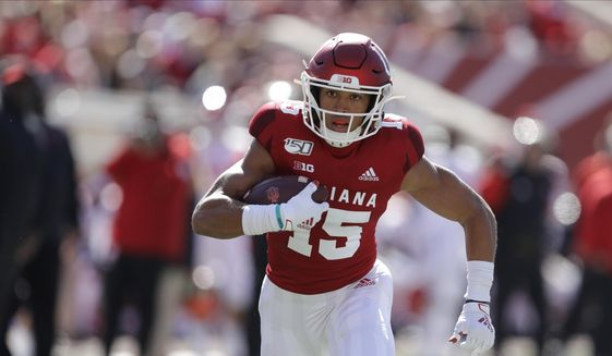 In this Oct. 12, 2019, file photo, Indiana wide receiver Nick Westbrook runs during the first half of an NCAA college football game against Rutgers, in Bloomington, Ind. Gone for the most part this year are access to in-person interviews, campus workouts and visits to team headquarters. Those who competed in college all-star games but didn't receive a combine invite, like Indiana receiver Nick Westbrook, have the advantage of performing in front of scouts. (AP Photo/Darron Cummings, File)  **FILE**