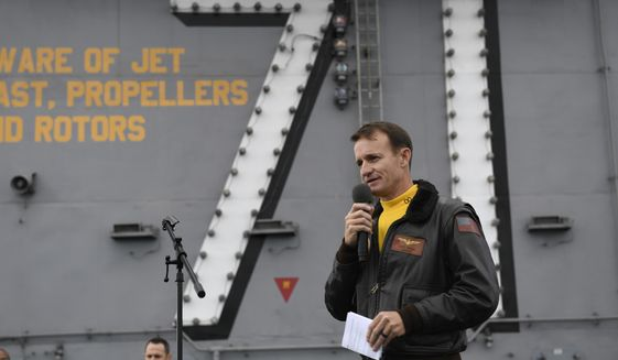 In this Nov. 15, 2019, photo U.S. Navy Capt. Brett Crozier, commanding officer of the aircraft carrier USS Theodore Roosevelt (CVN 71), addresses the crew during an all-hands call on the ship's flight deck. (U.S. Navy Photo by Mass Communication Specialist 3rd Class Nicholas Huynh via AP)