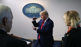FILE - In this March 31, 2020, file photo President Donald Trump speaks about the coronavirus in the James Brady Press Briefing Room of the White House in Washington, as Vice President Mike Pence and Dr. Deborah Birx, White House coronavirus response coordinator, listen. Trump in recent days has grumbled that American companies such as 3M and GM are not doing enough to provide American medical workers and first responders with vital equipment they need. (AP Photo/Alex Brandon, File)