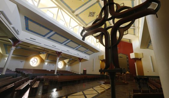 An empty sanctuary awaits parishioners on Palm Sunday at Saint Mary's Catholic Church Sunday April 5, 2020, in Richmond, Va. The church is not holding Mass but is opening the sanctuary for prayer. (AP Photo/Steve Helber)  **FILE**