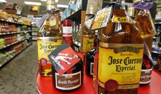 Alcohol sales spiked across the country in mid-March to a point rivaling holiday season boozing. (Associated Press/File)