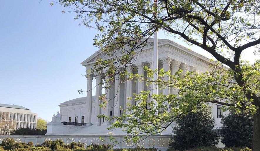 The Supreme Court is shown, Monday, April 6, 2020, in Washington. (AP Photo/Mark Sherman) ** FILE **