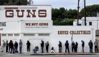 In this March 15, 2020, file photo, people wait in line to enter a gun store in Culver City, Calif. A federal judge is refusing to block Los Angeles officials from shutting down gun stores as nonessential businesses during the coronavirus pandemic. On Monday, April 6, 2020, the ruling the second time was that federal judges in California have declined to intervene in shutdown orders even as similar orders are being challenged nationwide. (AP Photo/Ringo H.W. Chiu, File)