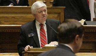 """FILE - In this April 3, 2009, file photo, Georgia Sen. Jack Hill, R-Reidsville, addresses fellow legislators about the state budget bill from the lower podium in the senate chamber during the last day of the legislative session in Atlanta. The Georgia Senate on Wednesday, Feb. 4, 2020, passed its version of midyear budget cuts in a nearly unanimous vote, approving a plan to cut $159 million in state spending for the fiscal year that ends June 30. """"This is a budget with few real adds, frankly,"""" said Hill, chairman of the Senate Appropriations Committee.  (AP Photo/John Amis, File)"""