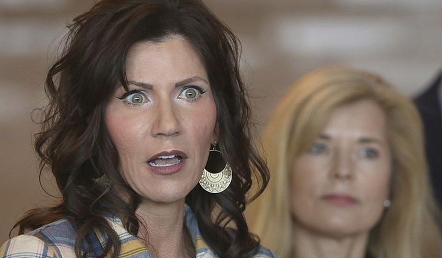 FILE - In this Wednesday, March 18, 2020 file photo, South Dakota Gov. Kristi Noem, left, updates media on the COVID-19 pandemic during a press conference at Monument Health in Rapid City, S.D. Gov. Noem on Monday, April, 6, 2020, doubled down on her effort to allow non-essential businesses in South Dakota to stay open through the coronavirus crisis despite calls for more action.The Republican governor did dial up the pressure on businesses and people particularly at-risk of hospitalization to limit the spread of infections. (Jeff Easton/Rapid City Journal via AP, File)
