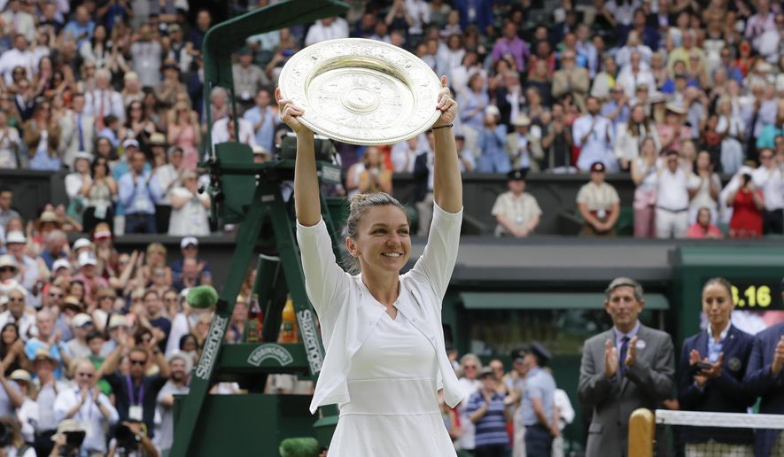 FILE - In this Saturday, July 13, 2019 file photo, Romania's Simona Halep holds up the trophy after defeating United States' Serena Williams in the women's singles final match at the Wimbledon Tennis Championships in London.  Wimbledon has been canceled for the first time since World War II because of the coronavirus pandemic. The All England Club announced after an emergency meeting that the oldest Grand Slam tournament in tennis would not be held in 2020. (AP Photo/Kirsty Wigglesworth, File)