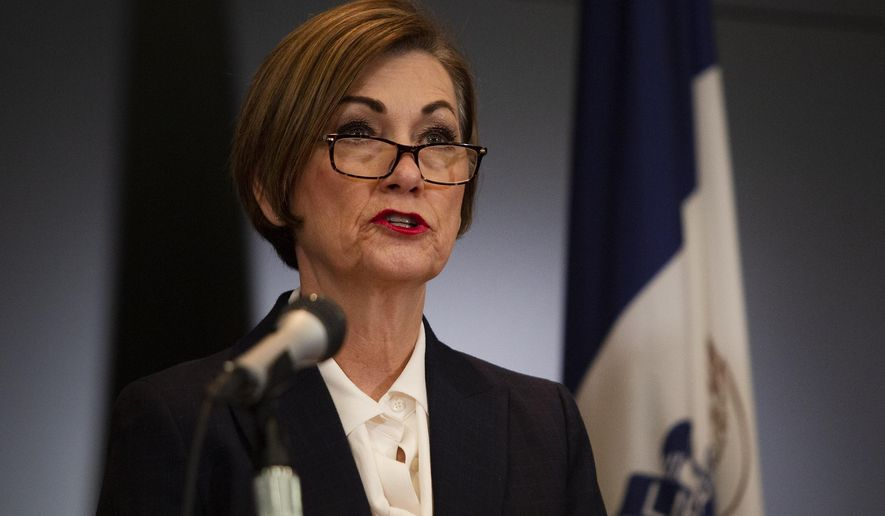 Iowa Gov. Kim Reynolds holds a news conference regarding COVID-19 at the State Emergency Operations Center in Johnston, Iowa, Monday, April 6, 2020. (Oliva Sun/The Des Moines Register via AP, Pool)